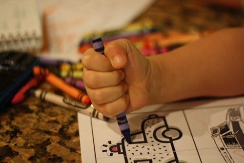 child holding crayon in fist