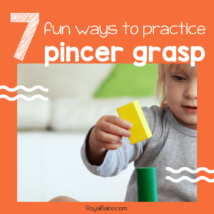 toddler using pincer grasp while holding a block