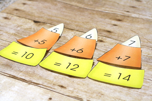 Free Candy Corn Math pack featuring addition, estimation, comparing numbers, and more!