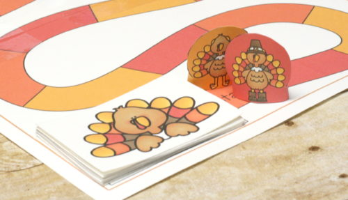 Turkey Trot Thanksgiving Addition Game. Practice counting on with simple addition in this fun Thanksgiving and Turkey themed free printable game.