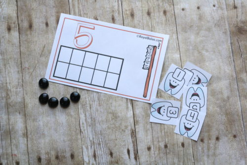 Practice math and good dental health with these adorable tooth counting mats. Count, add, compare, and more with these free printables!