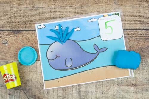 Sneak in math (counting and addition) with playdough! Sensory and educational with an ocean theme. Includes a whale, octopus, and clam.
