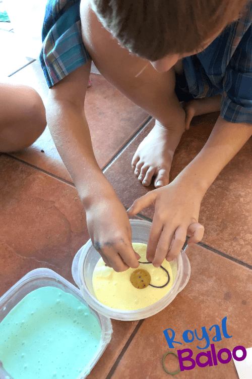 child creating cell out of slime and rubber band